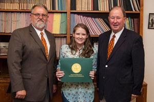 Ashley Rhea receiving service award