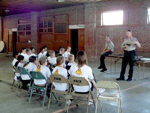 image of officers teaching about gun safety
