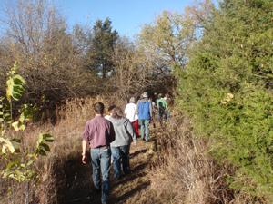 image of volunteers walking through trail