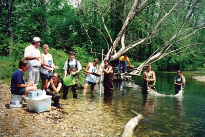 image of Blue Thumb team performing tests to monitor stream water quality