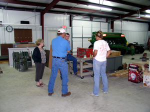 image of guests visiting new equipment shop