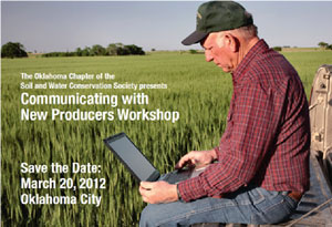 image of man on computer in field