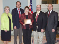 image of Lt. Gov. Jari Askins; Trey Lam, OACD, Reva Maddox, secretary, and Clint Olson, director, East Woods County Conservation District; and Mark Thomas, OPA executive vice president