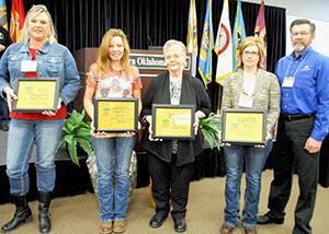 image of employees holding awards