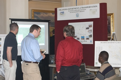 image of men visiting booth