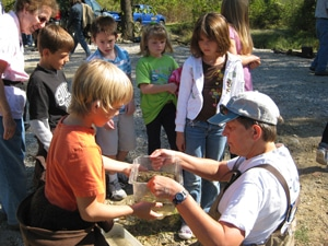 image of Jean Lemmon showing insect collections to students
