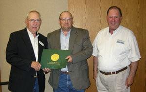 Monty Ramming receiving service award