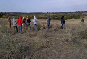 FFA and 4H members and adults in rangeland.