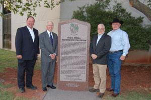 image of men standing near granit monument