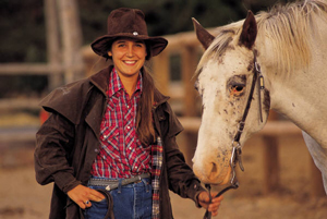 image of young woman with horse