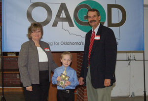 image of OACD President presenting student with an award