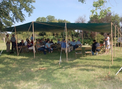 image of attendees under tent