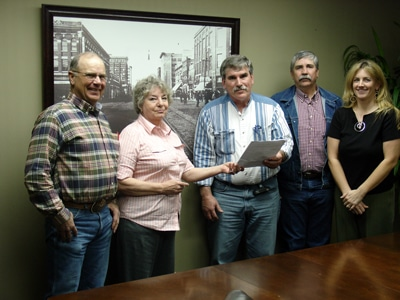 image of Bonnie Greer presenting deed to Muskogee County CD.