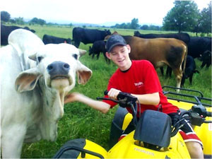 image of young boy with a cow