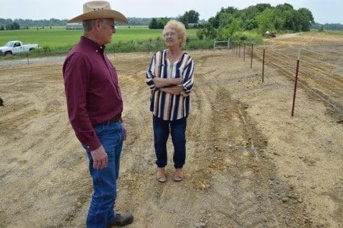 Man and woman talking in field